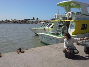 Woman waiting at the boat terminal in Belize City
