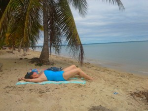 Relaxing under a palm tree on the beach in Hopkins, Belize