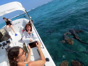 This is a photo of two women on a boat heading out to the Belize Barrier Reef with Carlos Tours, Caye Caulker