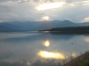 photo of a sunset over the waters of the Ashokan Reservoir showing a back drop of the mountains