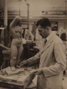 photo of a man making a sculpture of a nude female at the Art Students League of NY